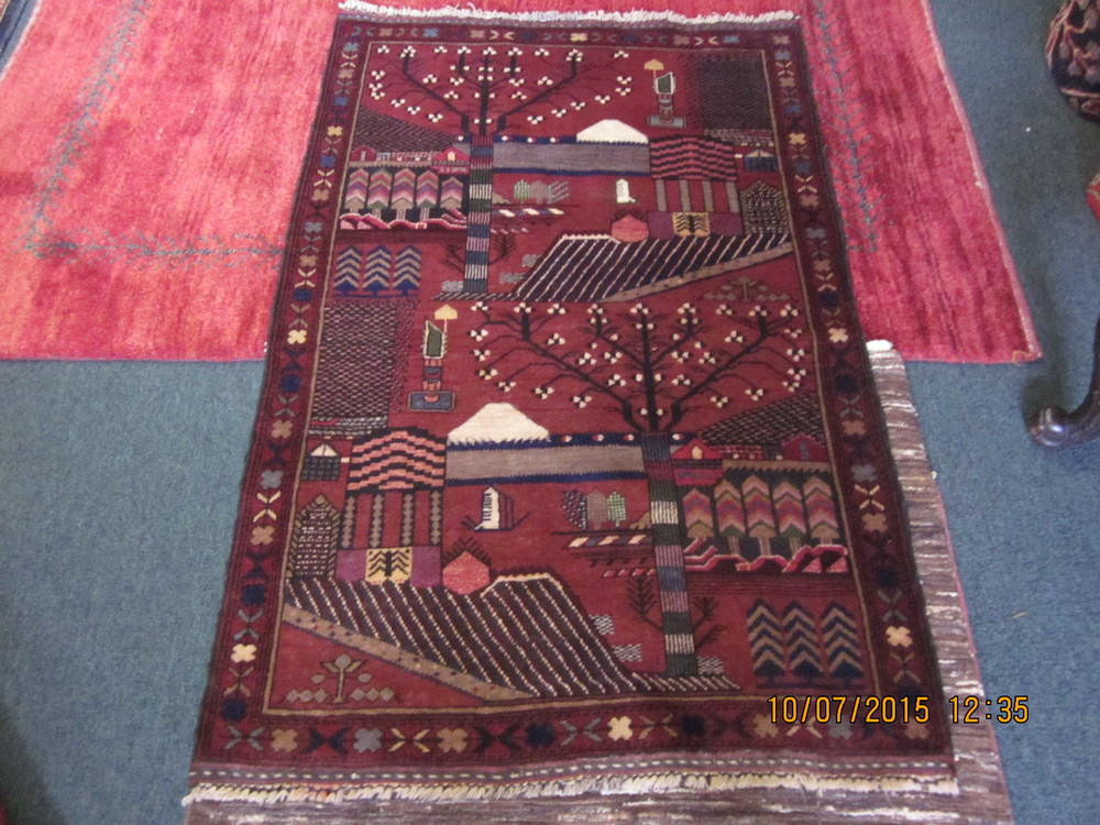 """#28) 2'10"""" x 4'3"""" Lovely pictorial Balouch rug."""