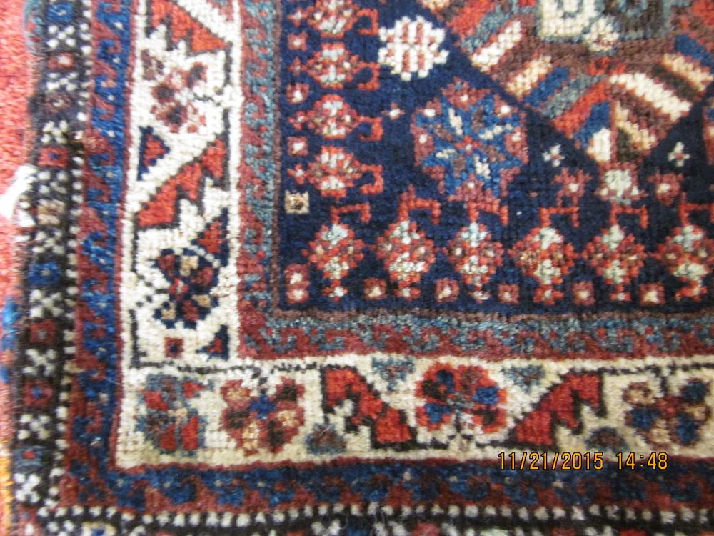 #31b) Antique tribal bag close up.
