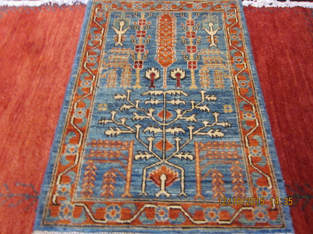 #34) 2' x 3' Tree of Life rug in light blue.