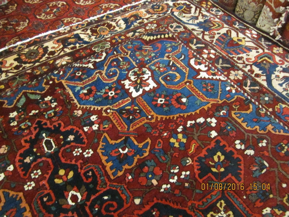 #60) Close up on the jewel tones in this beautiful antique Persian carpet.