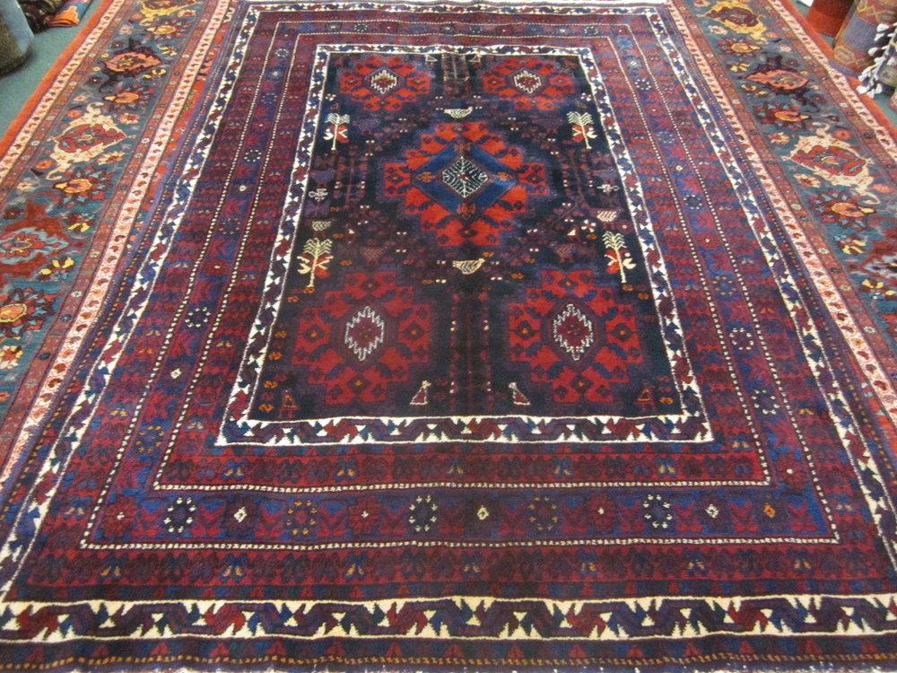 #37) Semi-antique Persian Afghar rug. 5 x 7