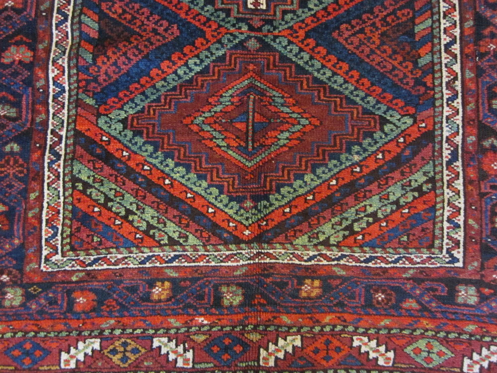 """The colors are still very clear and the pistachio green sparkles.  4'7"""" x 6'8"""" very old tribal rug in my collection."""