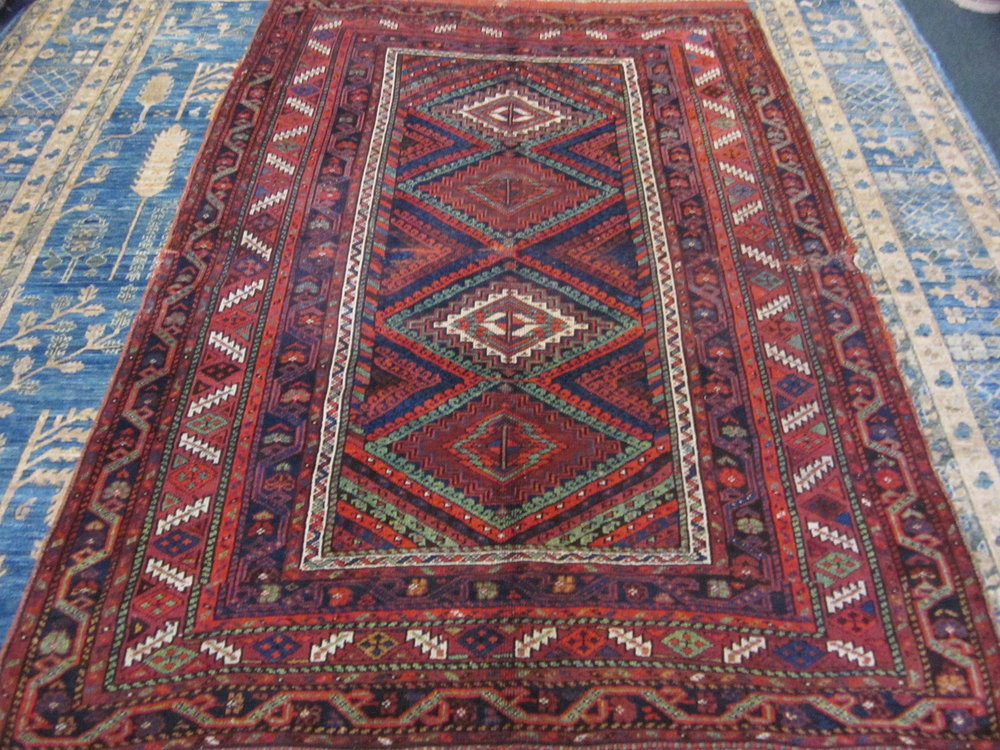 Antique Kurdish rug.