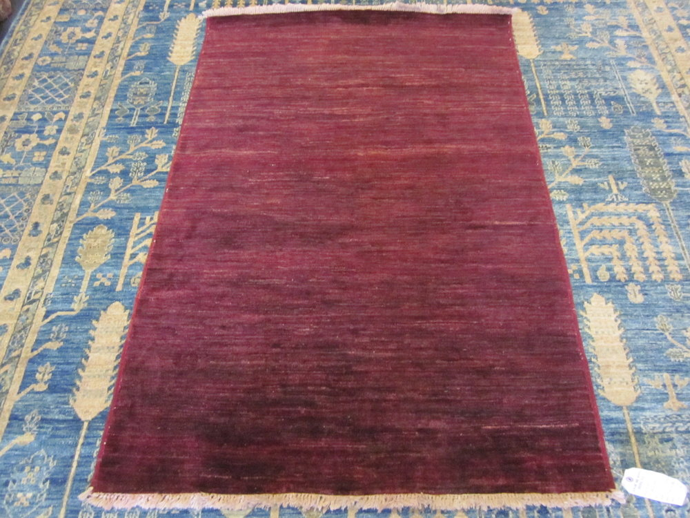 "3'2"" x 4'9"" Afghan Modern in a deep crimson red."