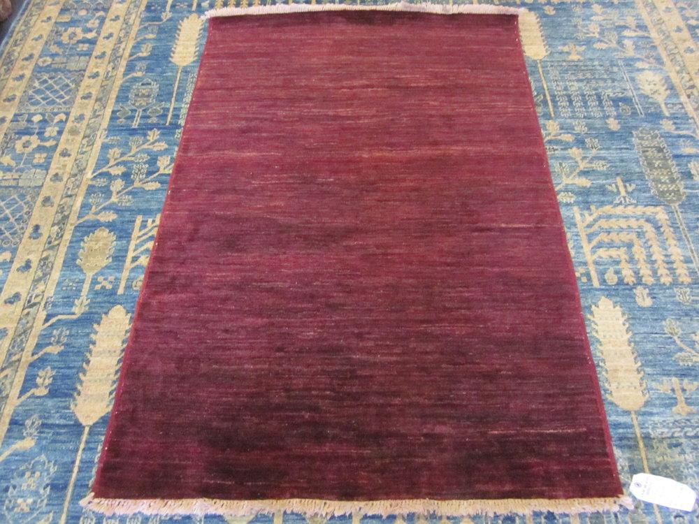 "#39) 3'2"" x 4'9"" Afghan Modern in a deep crimson red."