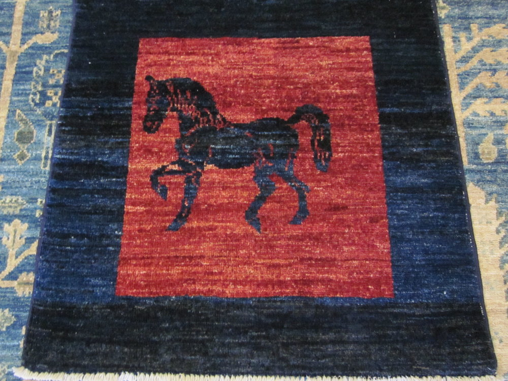 Lovely small Oriental rug.