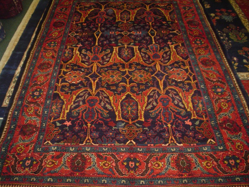 Photo: Persian Bijar rug in deeply saturated colors