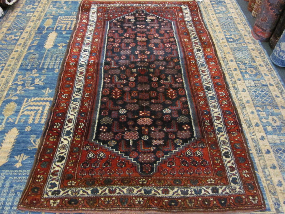 #33) 4' x 7' semi-antique Kurdish Senna. Iran.