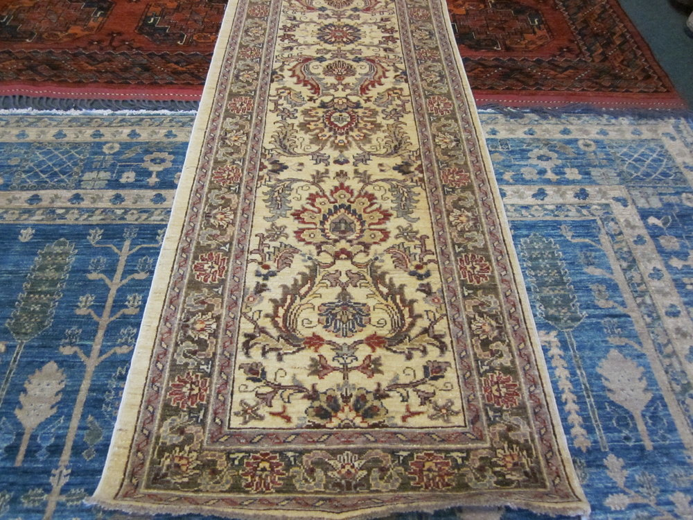 "43) 2'7"" x 10' Lovely Afghan runner a soft floral design."