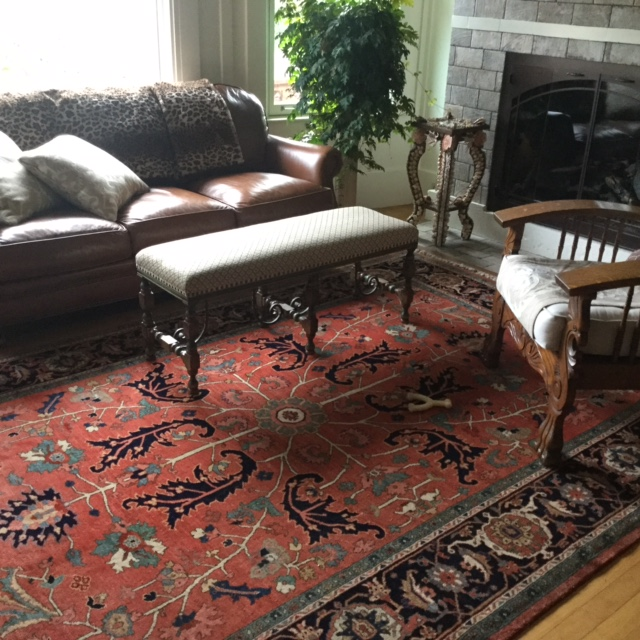 Perfectly chosen tribal rug in a beautifully decorated space.