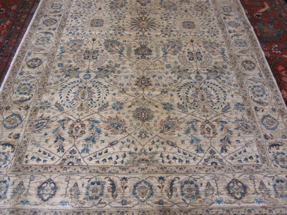 """#28) 5'2"""" x 8'6"""" finely woven Tabriz design Afghan rug in soft colors."""