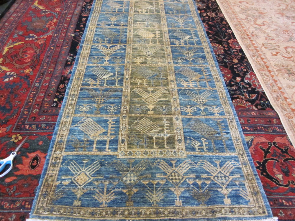 "2'10"" x 9'10"" Akstafa peacock design runner in light blue."