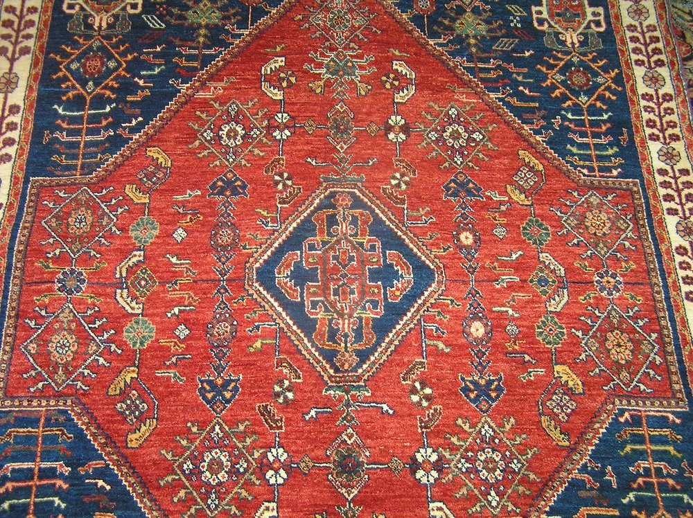 "#35b) 5'1' x 6'6"" Qashqai rug close-up."