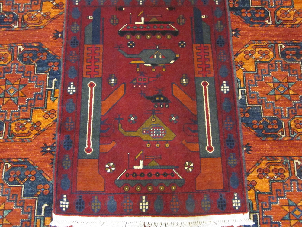 """Afghan War Rug! 2' x 2'9"""" in deeply saturated colors."""