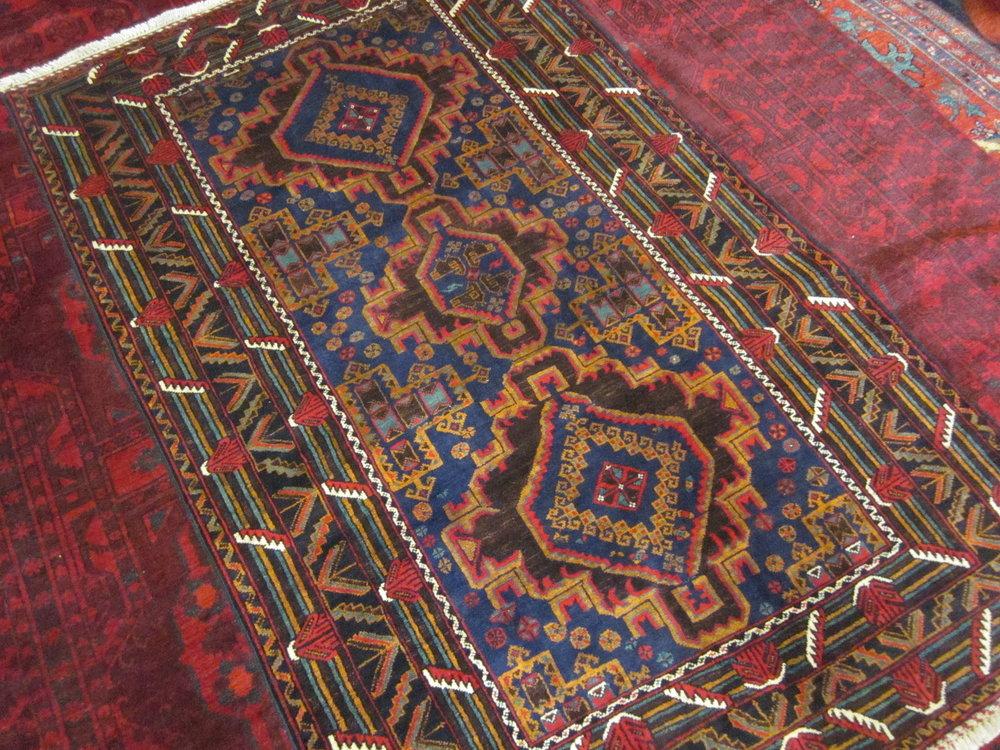 """#46) 6' x 6'6"""" Balouch rug."""