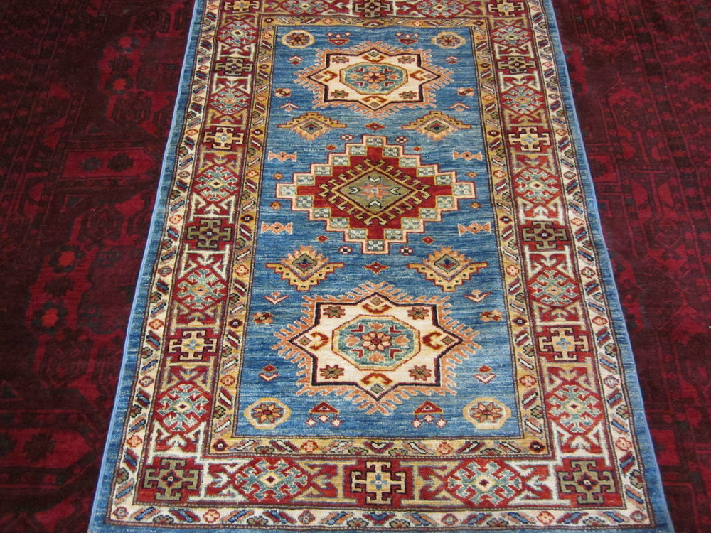 "51) 3'3"" x 4'9"" Light blue Kazak rug."