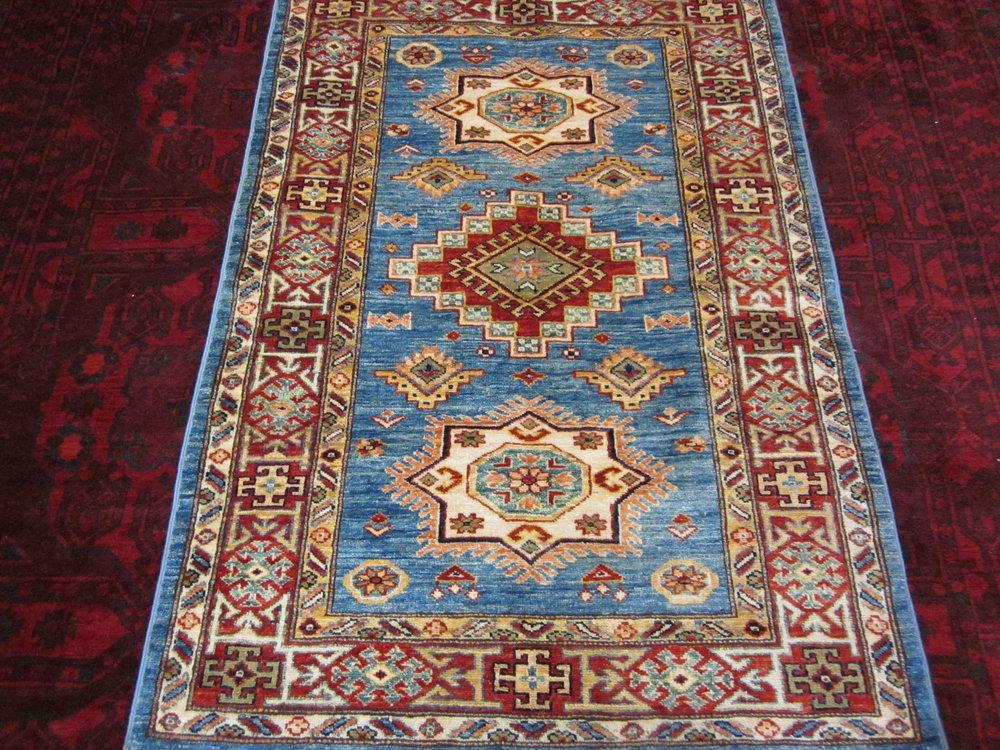 """51) 3'3"""" x 4'9"""" Light blue Kazak rug."""