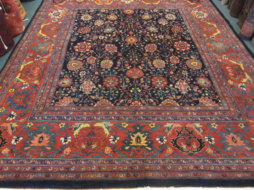 Photo: Shaw Abbas Bidjar rug, 8 x 10 in deep colors of navy blue and reds. Sold.