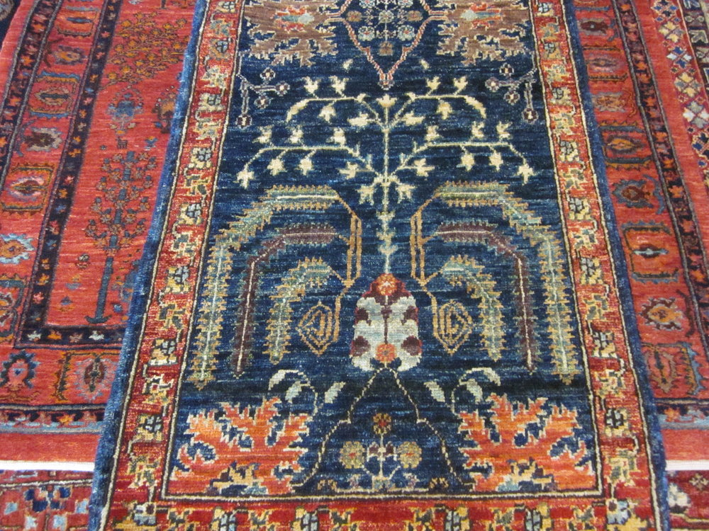 #59) Lovely small Afghan rug in a tribal design. 2' x 3'.