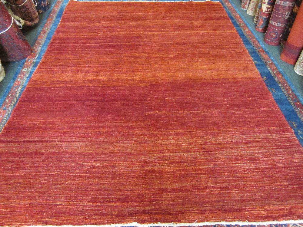 """#53) 6'7"""" x 9'11"""" Modern Afghan rug."""