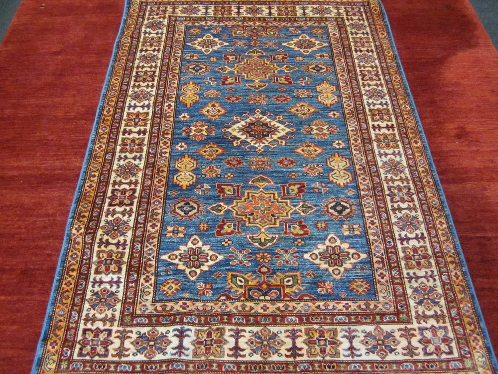#68) 4' x 6' Kazak in light blue.