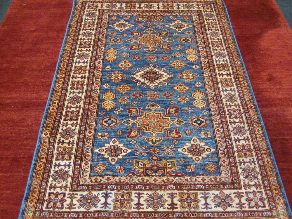4' x 6' Kazak in light blue.