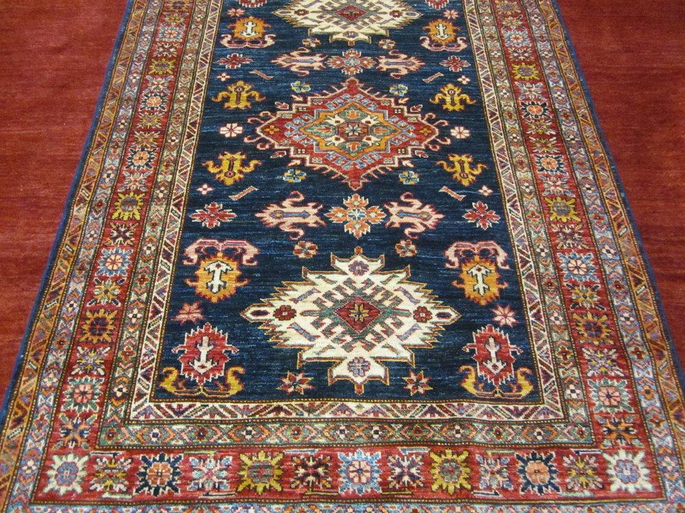 4' x 6' Navy Kazak rug.