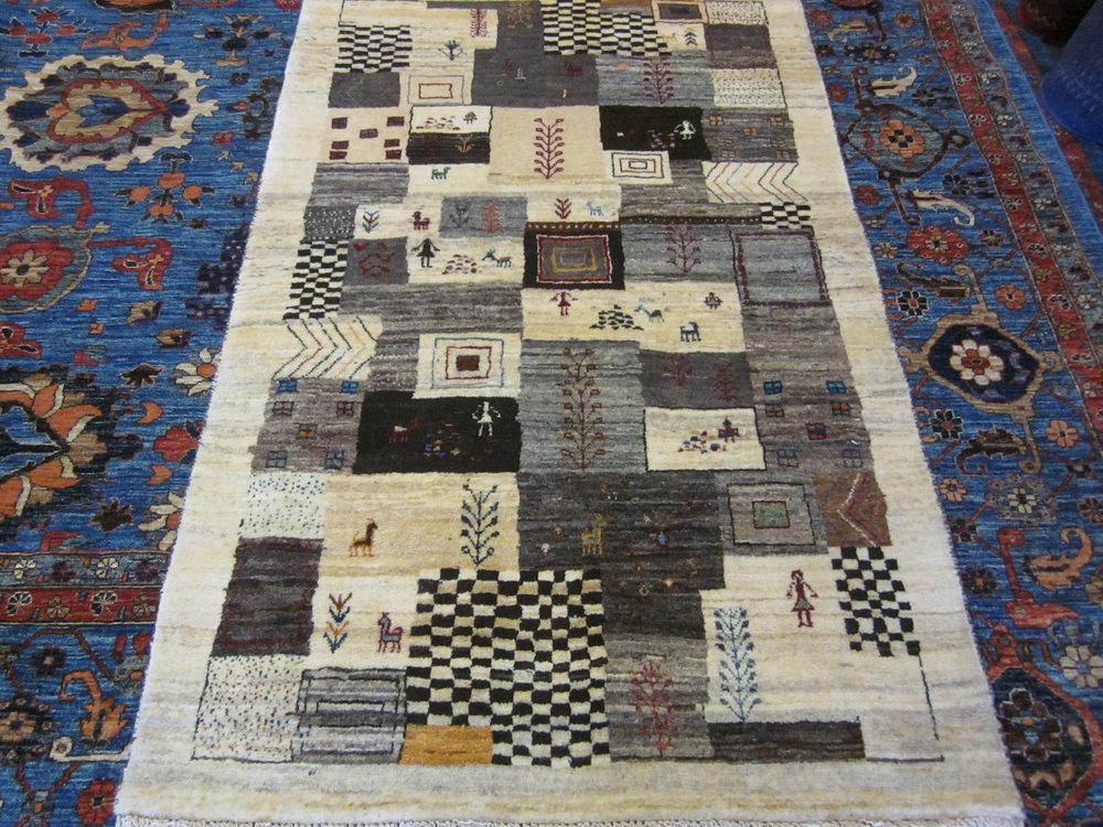 "3'5"" x 5'4"" Persian Gabbeh rug."