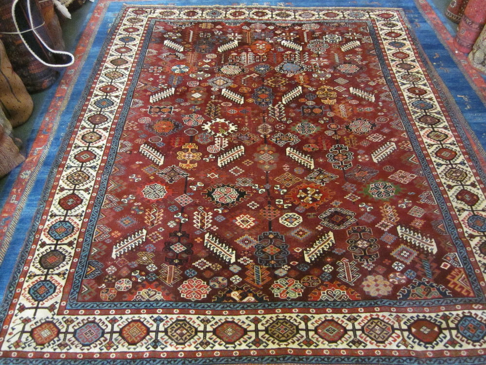 """6'2"""" x 7'8"""" Antique Shekarlu Qashqai rug. Circa 1860. Finely woven with deeply saturated, glistening jewel toned colors."""