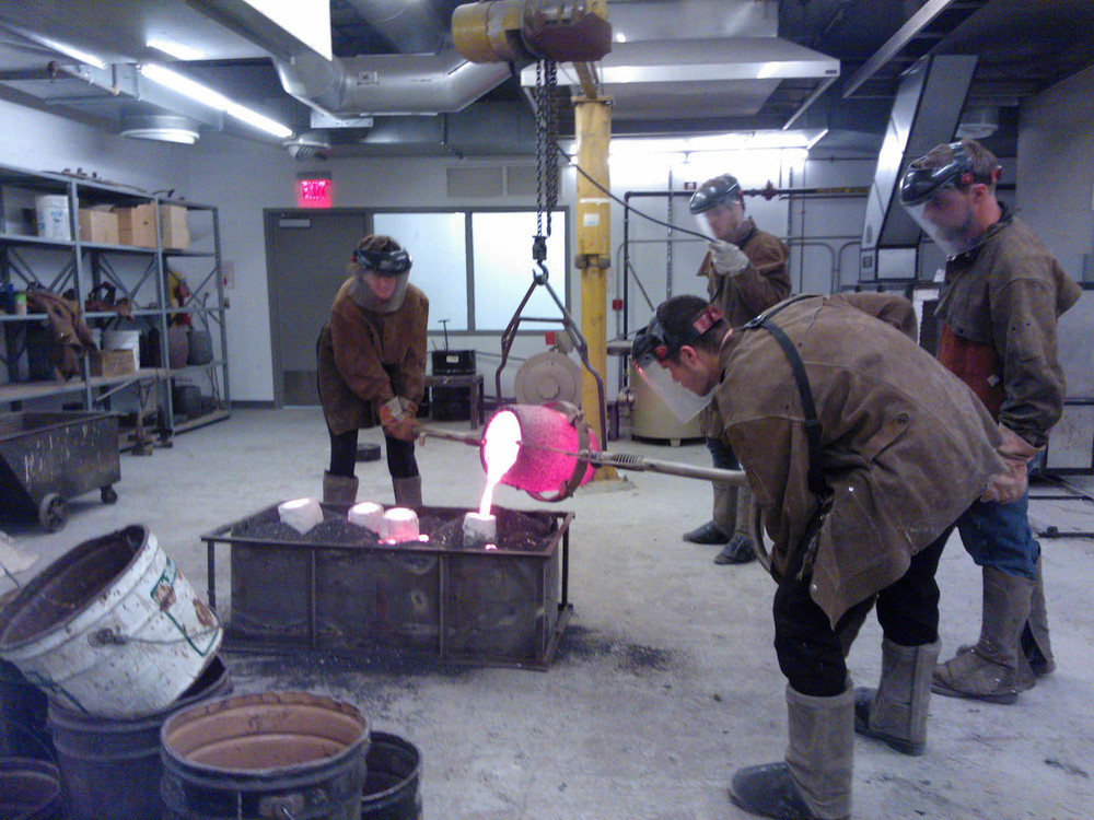 6 Molten bronze poured into empty shell.jpg