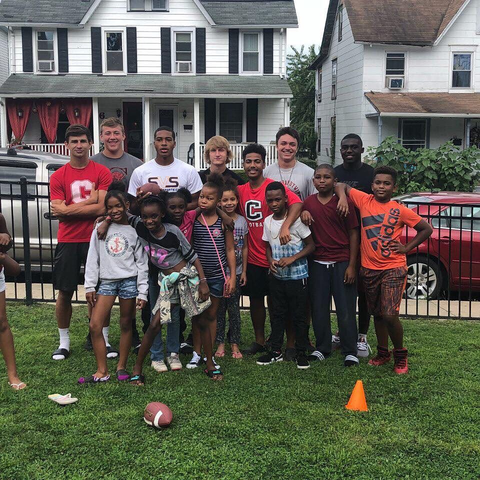 Coatesville players volunteering this summer at The Bridge Academy.