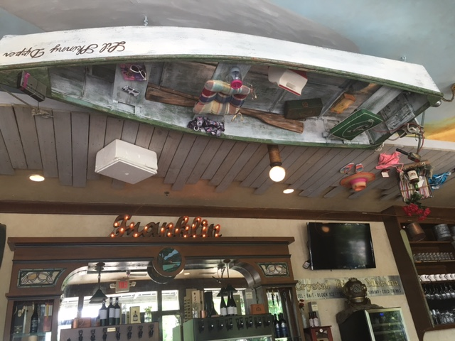 Boats glued to the ceiling at  Puckett's Boat House . Look at the detail...swimsuits, picnics, tackle.