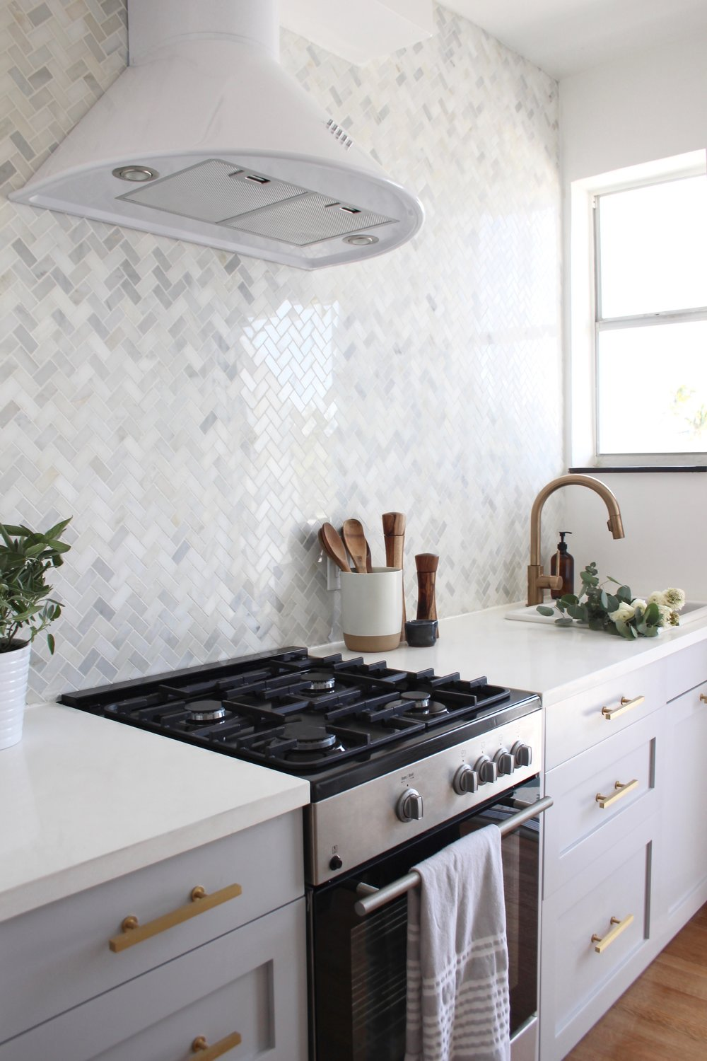 grey kitchen with marble backsplash - the habitat collective - project deco by the docks.jpg