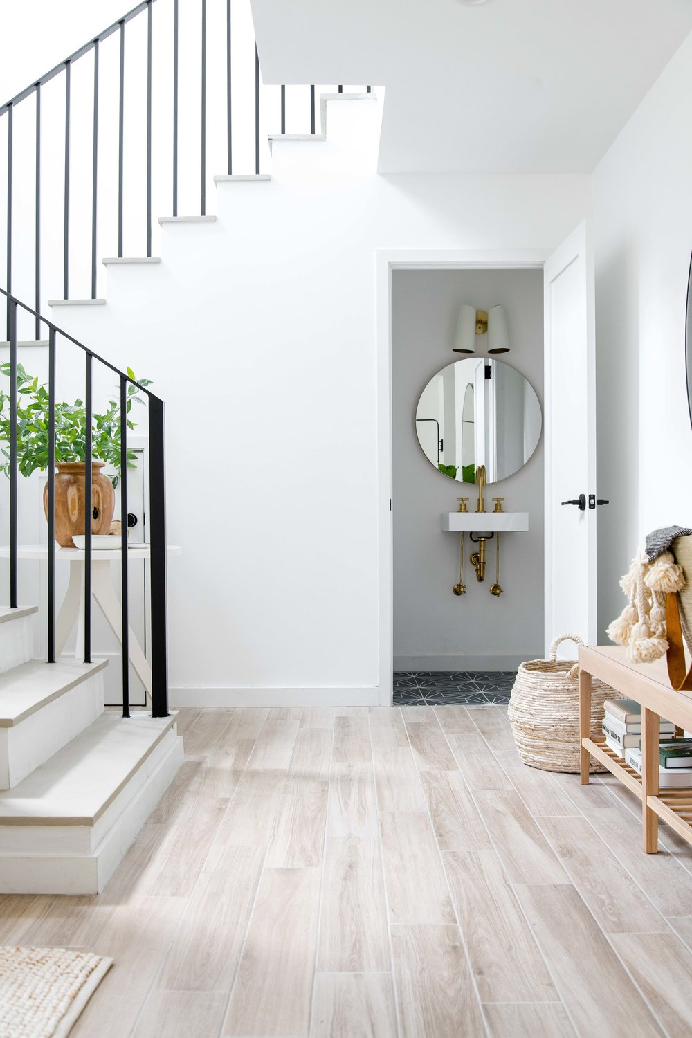 modern entryway with black stair railing - the habitat collective interior design - #projectpeachy