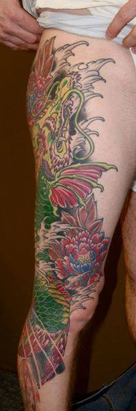anthony-filo-rochester-tattoo-artist-leg-sleeve.jpg