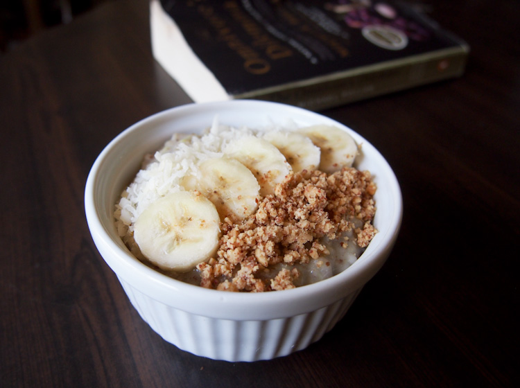 Banana oatmeal with ground peanuts and shredded coconut