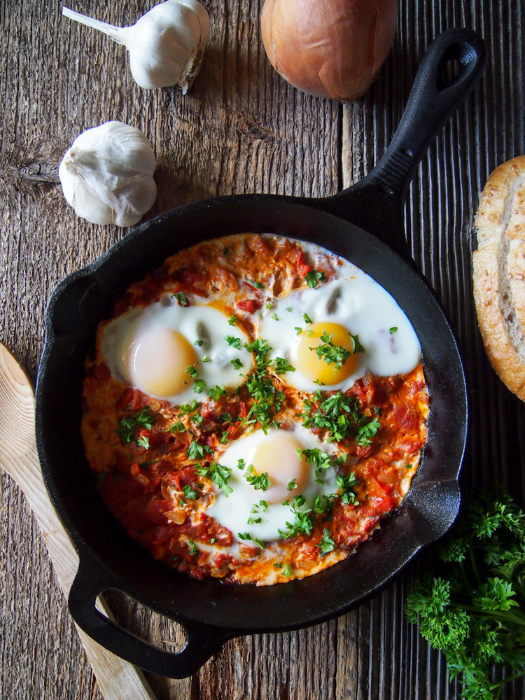 Shakshuka (Eggs in Tomato Sauce) | vermilionroots.com. This egg and tomato dish of North African origin is a quick and easy way to get a hearty meal on the breakfast or brunch table.