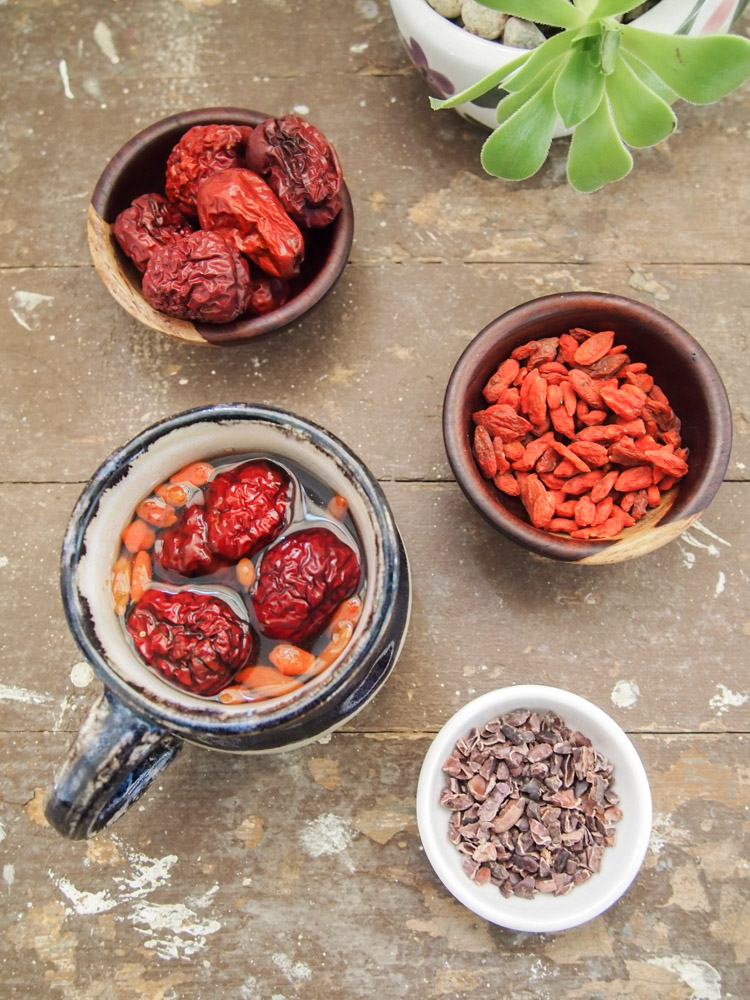 Jujube Tea with Cacao Nibs  and Goji Berries| vermilionroots.com. A delicious tea with earthy sweetness from dried jujubes and dried goji berries, and a hint of smokiness from cacao nibs.