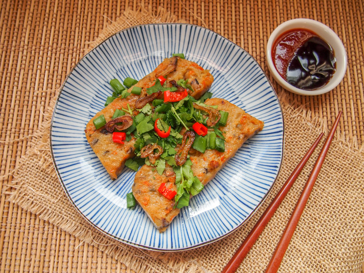 Chinese Turnip Cake | vermilionroots.com. A savory dim sum steamed cake made with turnip, carrot and mushroom to be enjoyed with hoisin and sriracha sauce.