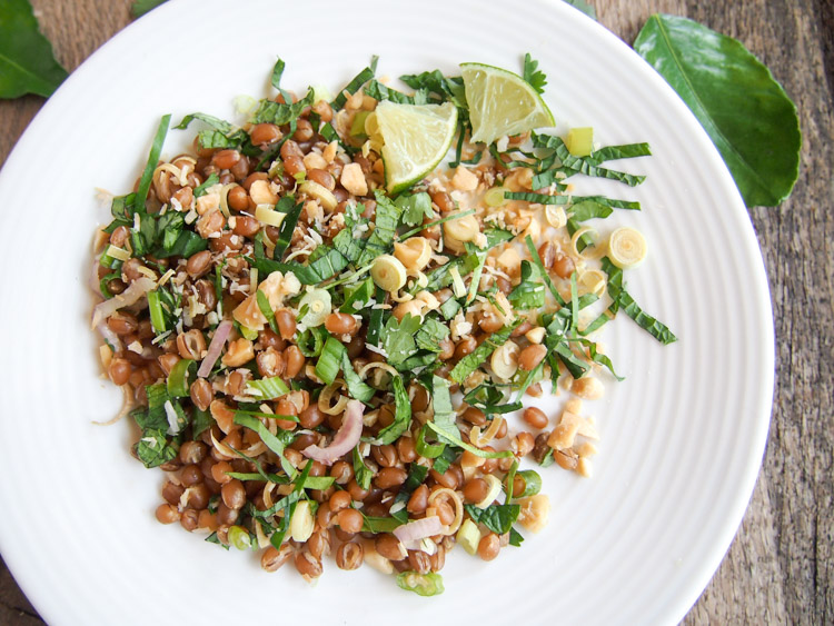 Malaysian Herb Salad (Ulam) | vermilionroots.com. A tantalising Malays salad made with raw herbs, coconut, peanuts, lime juice, and your favorite grains such as wheat berries or rice.