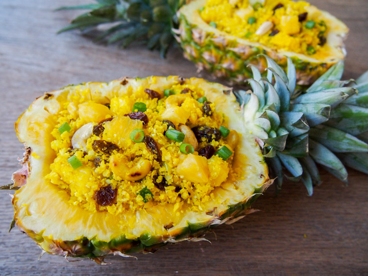 Pineapple Boat Fried Cauliflower Rice |   vermilionroots.com  .   A lighter version of a popular Thai-style fried rice using low-carb cauliflower instead.
