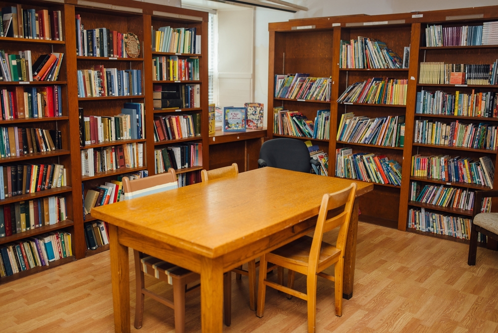 Our quaint library encourages a love of reading. Fun fact: This library was used by the Redemptorist Priests before we moved in and continues to offer a beautiful and cozy space for reading and learning.