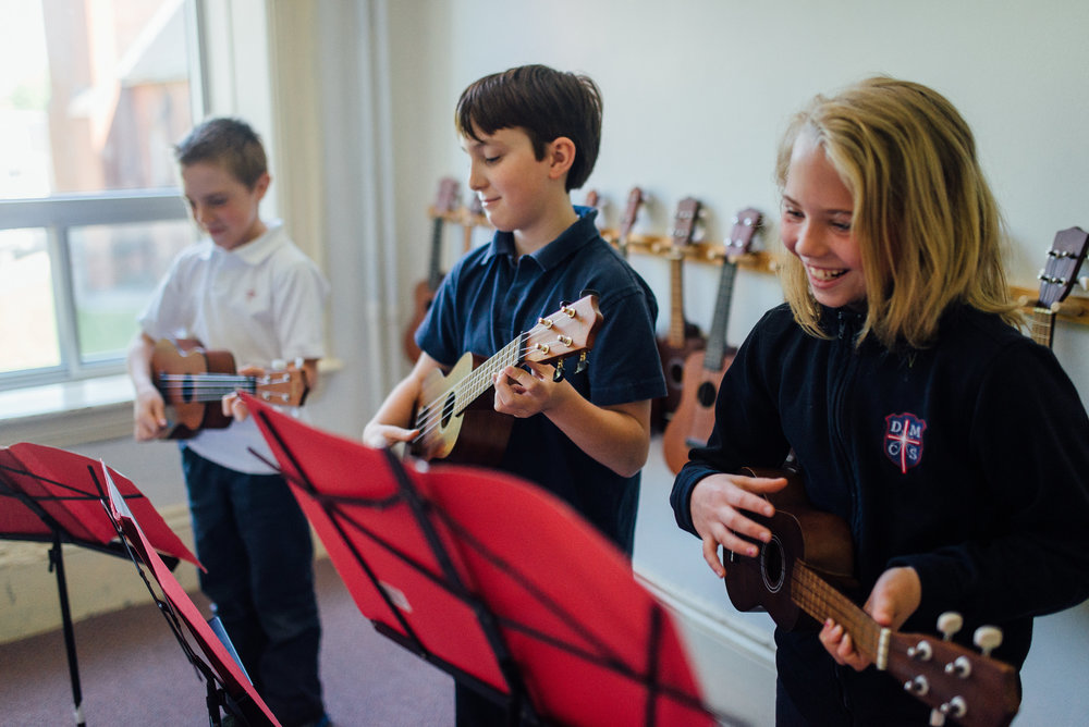 We love Music! Here at DMCS, we encourage students to discover their talents and gifts and to use them to bring joy to others. 50 of our 75 students are members of the DMCS Choir. Our music room is home to many different instruments to allow students to try a variety!