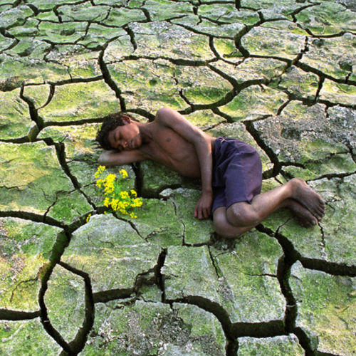 boy sleeping on ground india