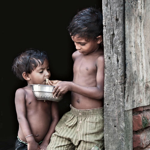 boy sharing food with friend