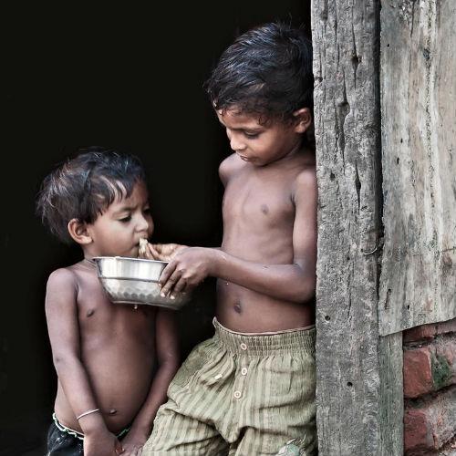 boy sharing food with friend