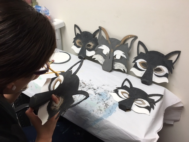 Lorena hard a work adding detail to the wolf pack masks