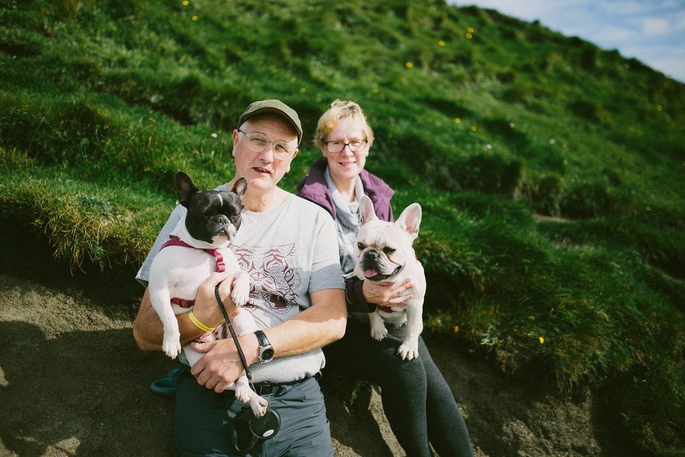 Some fellow tourists at the Cliffs of Moher in Ireland. They were English but their bulldogs were French. I offered to take this for them and emailed it to the guy later. It was a nice memory.