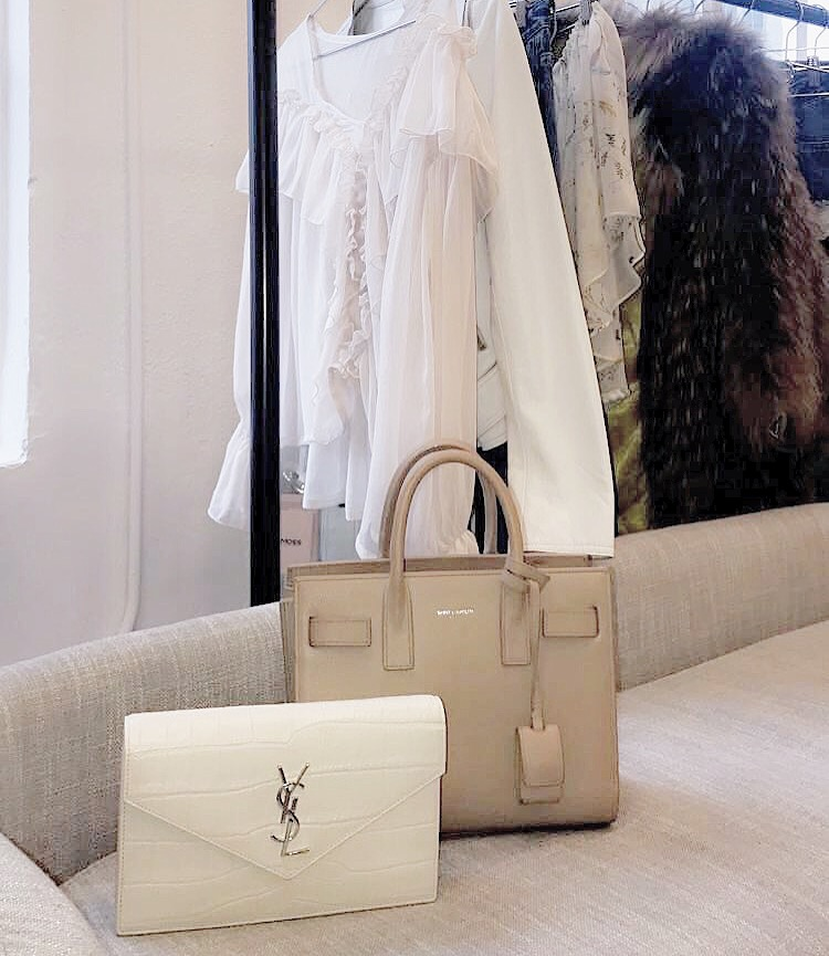 Olivias white YSL clutch and Natalies YSL bag.