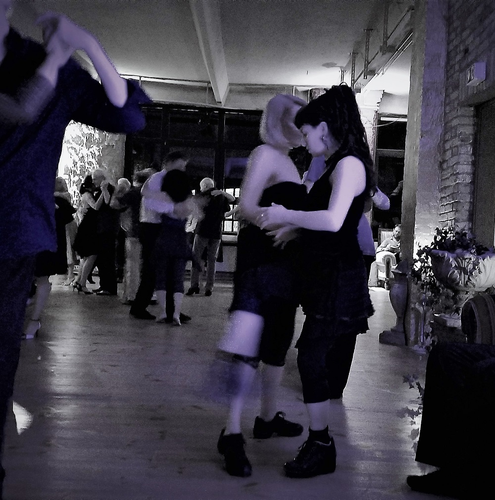teacher and student at milonga